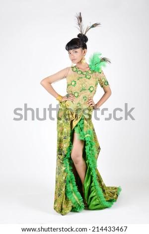 portrait of asian teenage girl dressing up in green kebaya modification on white background #214433467
