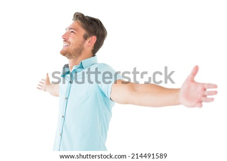 Handsome young man posing with arms out on white background #214491589