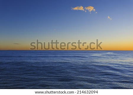 Picture of a dawn on the open sea.