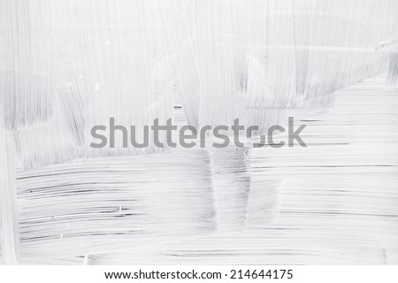 White paint layer on glass wall, background texture Royalty-Free Stock Photo #214644175