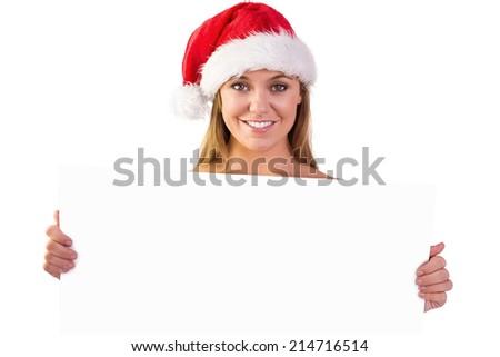 Festive blonde smiling at camera on white background #214716514
