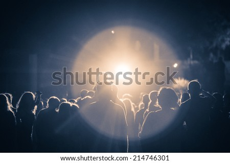crowd at a concert in a vintage light. grain added #214746301
