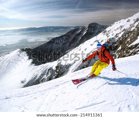 Skier skiing downhill in high mountains #214911361