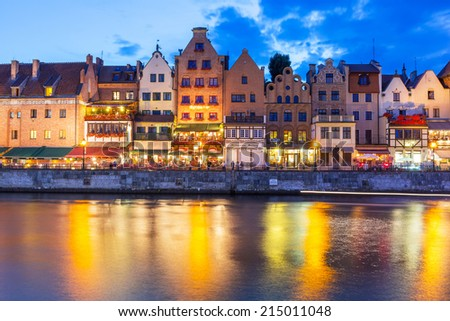 GDANSK, POLAND - 25 JULY 2014: Old town of Gdansk at night with reflection in Motlawa river. Gdansk is the historical capital of Polish Pomerania with medieval old town architecture. #215011048
