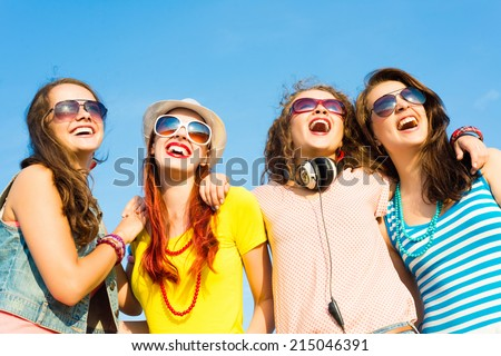 group of young people wearing sunglasses and hats hugging and standing in a row, spending time with friends #215046391