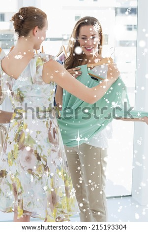 Young women shopping in clothes store against snow falling #215193304