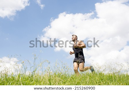 Strong athletic man running on the field. #215260900