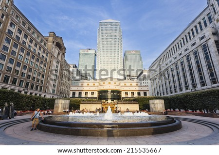 LONDON - AUGUST 21: Cabot Square in the modern Canary Wharf quarter with its banks and skyscrapers in the evening on August 21, 2013 #215535667