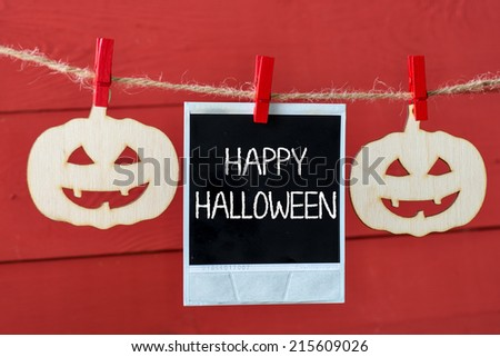 Wooden pumpkin hanging on rope with old photo,Halloween decoration.Halloween party sign on