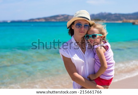 Young mother and her adorable little daughter during summer vacation #215661766