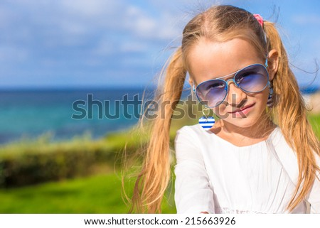 Portrait of adorable little girl outdoors during summer vacation #215663926