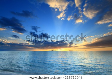 Panoramic dramatic sunset sky and tropical sea at dusk  #215712046
