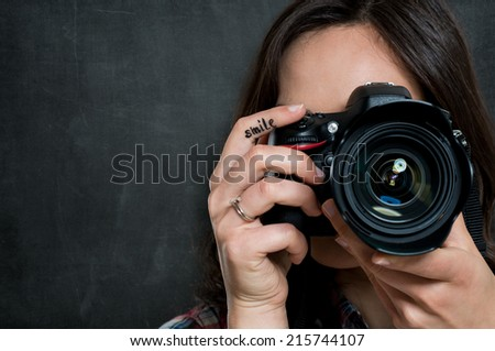 Closeup Of Young Woman Using Camera Over Gray Background #215744107