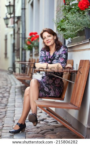 The   woman of mid age in cafe , old Riga , Latvia #215806282