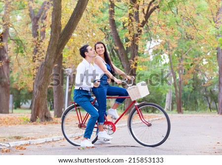 Teen couple with bike in the park in autumn time #215853133