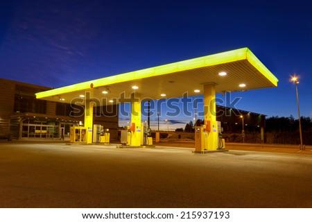 Empty gas station with blue night sky in Vuosaari, Finland #215937193