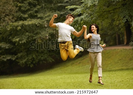 Couple in Love. Happy Couple Running in the park #215972647
