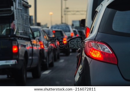 traffic jam with a lot of cars on express way  Royalty-Free Stock Photo #216072811
