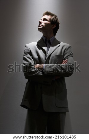 Businessman with arms crossed, looking up #216101485