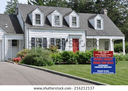 Real Estate For Sale Open House Welcome Sign on front yard lawn of Suburban Cape Cod Colonial Style Home Sunny Residential Neighborhood USA