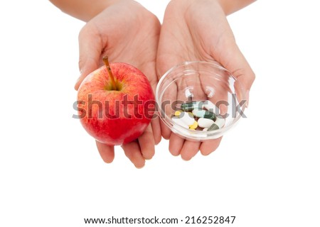 Hand hold medicine and apple  isolated on white background #216252847