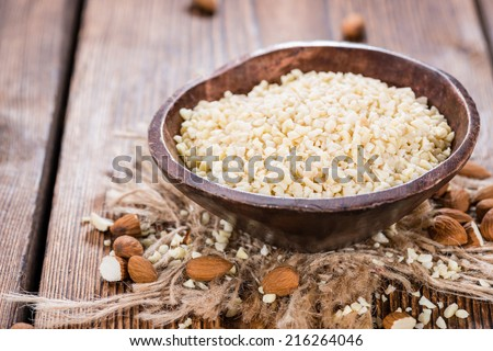 Almond Pieces (detailed close-up shot) on wooden background #216264046