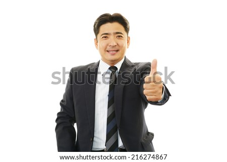 Smiling businessman with thumbs up #216274867