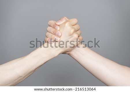 Hand holding hand isolated over gray background - Friendship, Shaking hands Business, Congratulation #216513064