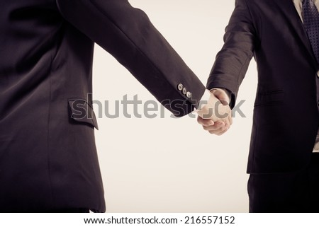 Two business people shaking hands. Isolated on white background. #216557152