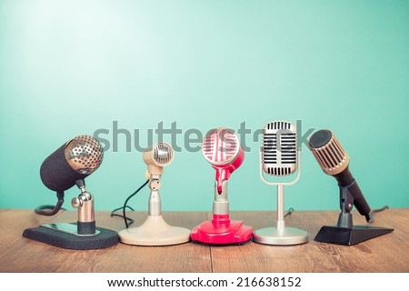Retro old microphones for press conference or interview on table Royalty-Free Stock Photo #216638152