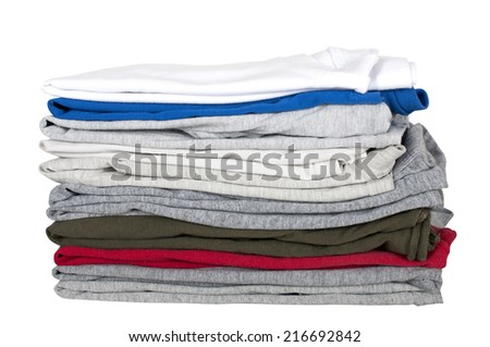 children's t-shirts stacked in a pile isolated on white #216692842