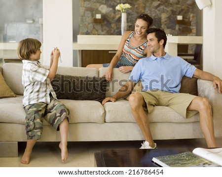 Boy photographing his parents #216786454