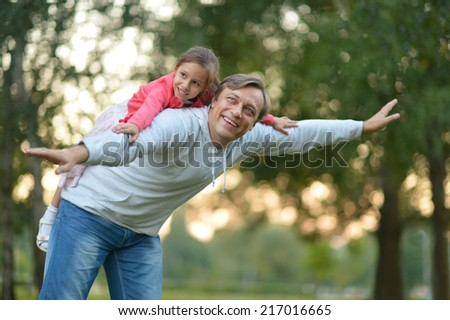 Father with her little daughter playing in nature #217016665