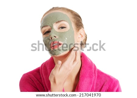 Relaxed woman with  a deep cleansing nourishing face mask applied to her face, beauty and skincare concept #217041970