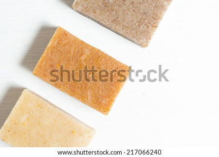 three soap blocks on white wooden table, not isolated #217066240