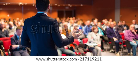Speaker at Business Conference and Presentation. Audience at the conference hall. Royalty-Free Stock Photo #217119211