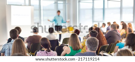 Speaker at business workshop and presentation. Audience at the conference room. Royalty-Free Stock Photo #217119214