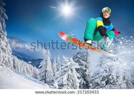 flying snowboarder on mountains  #217203433