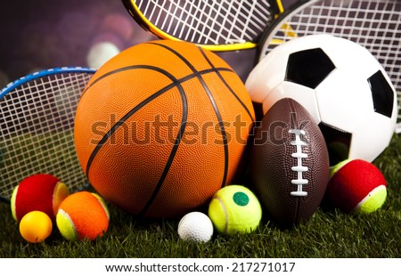 Assorted sports equipment and grass Royalty-Free Stock Photo #217271017