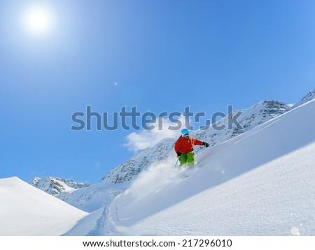 Skiing, Skier, Freeride in fresh powder snow - man skiing downhill #217296010
