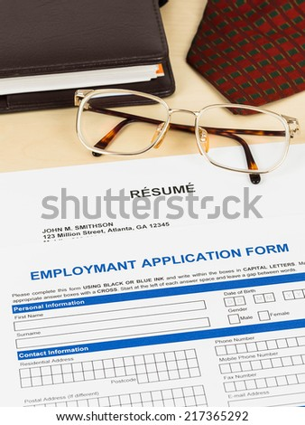 Application form, resume, neck tie, glasses, and planner #217365292