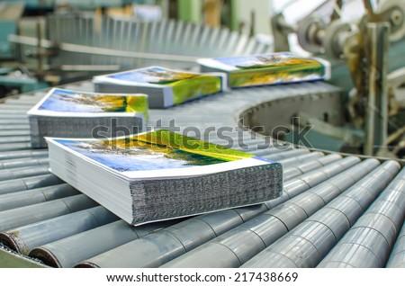 Print shop (press printing) - Finishing line. Post press finishing line machine: cutting, trimming, paperback and binding #217438669