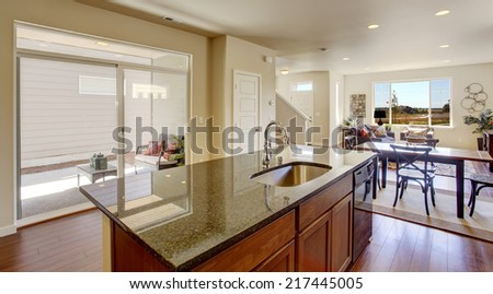 Bright house interior. Kitchen room with kitchen island and walkout deck #217445005