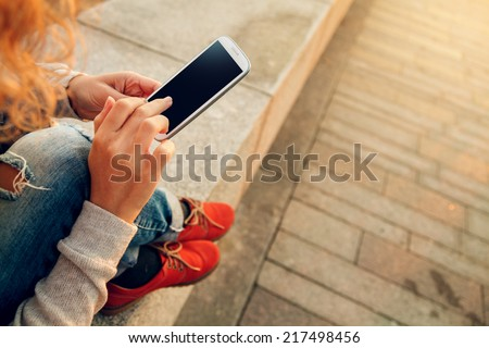 Beautiful young  hipster woman using smart phone at beach
