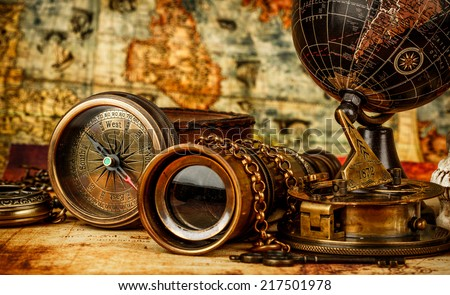 Vintage grunge still life. Vintage items on ancient map. Royalty-Free Stock Photo #217501978
