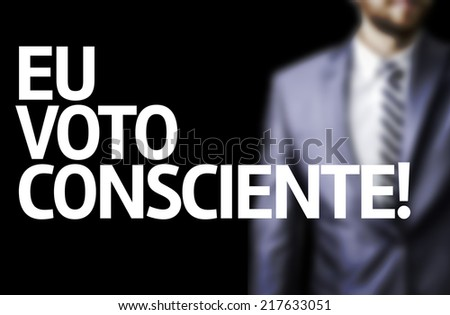 I Vote Conscientiously (In Portuguese) written on a board with a business man on background #217633051