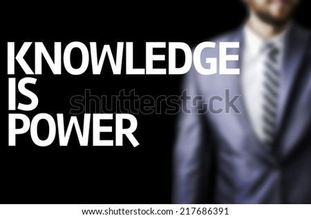 Knowledge is Power written on a board with a business man on background #217686391