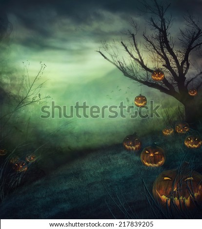 Halloween design - graveyard pumpkins. Horror background with autumn valley with woods, spooky tree and evil pumpkins. Space for your Halloween holiday text. #217839205