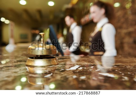 Modern luxury hotel reception counter desk with bell Royalty-Free Stock Photo #217868887