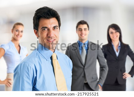 Portrait of a smiling businessman in front of his team #217925521